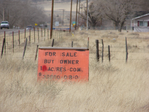 Sign reading For Sale Buy Owner